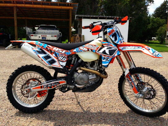 Motofx graphics sponsors top snowmobile athletes with custom motocross graphics kits for their summer toys
